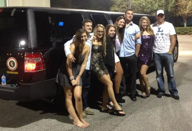 Birthday Party guests pose with our Limo