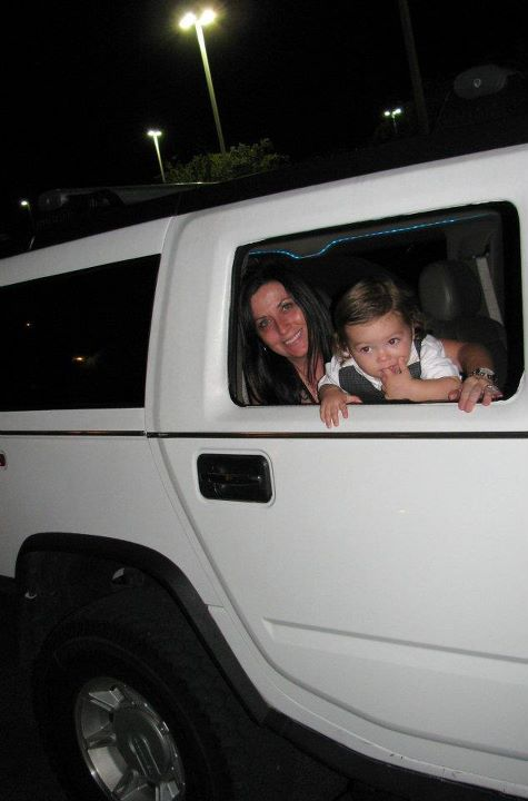 A proud Grandma and her grnad baby pose in Hummer Limo