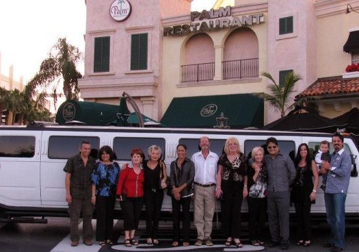 Happy Birthday group poses with our Hummer H2 Limo